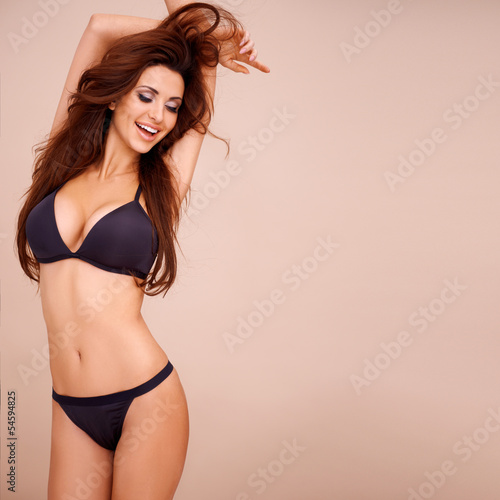 Obraz Sexy laughing woman in black lingerie - fototapety do salonu
