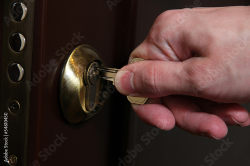 Fototapety, obrazy: Someone opens door key close-up
