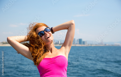 Young woman against sea