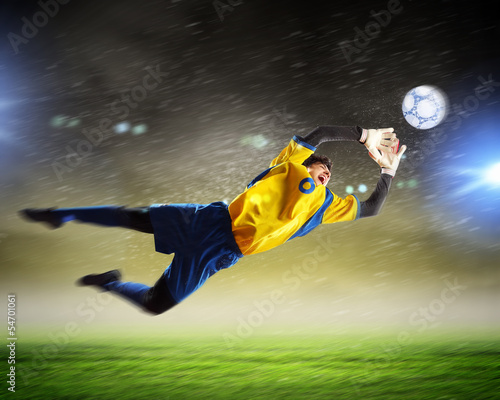 Fototapety, obrazy: Goalkeeper catches the ball