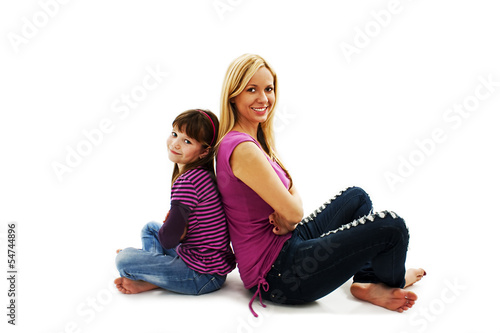 Fotografie, Obraz  Beautiful mother and daughter sitting on the floor