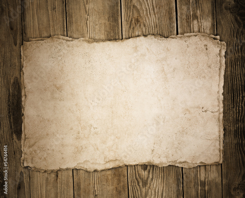Old paper on the wood background - 54764414