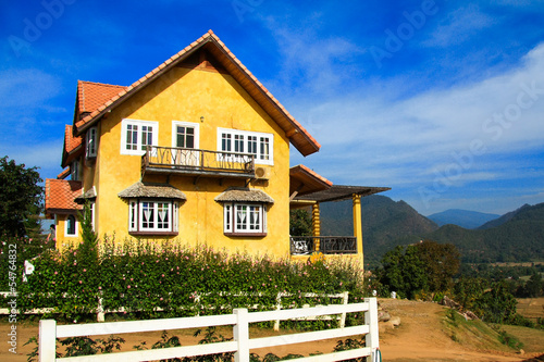 фотография Yellow House in Pai over the blue sky, North of Thailand