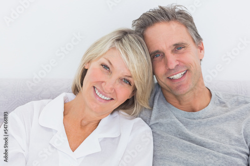 Cheerful couple in bed Poster