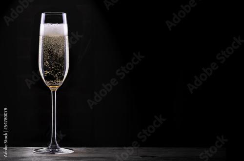 Fotografie, Obraz  glass of champagne isolated on black background