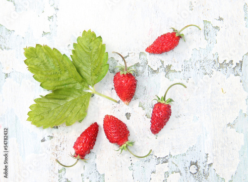 Foto op Canvas In het ijs strawberry on the shabby surface of the wood