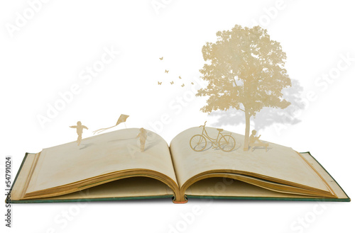 Photo  Paper cut of children play on old book