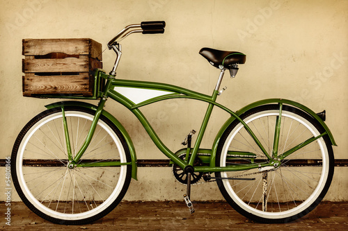 Foto op Plexiglas Fiets Retro styled sepia image of a vintage bicycle with wooden crate