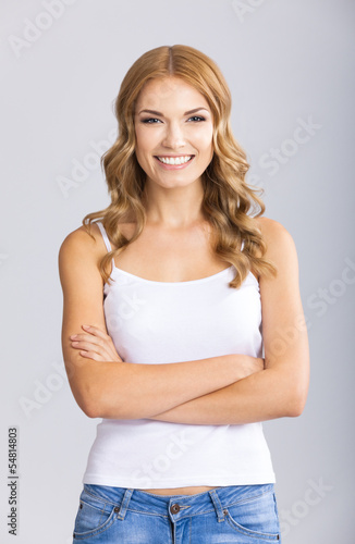 Happy smiling blond woman, over grey