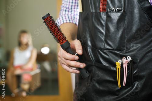 portrait of man working as hairdresser in shop