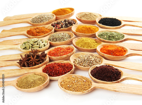 Tuinposter Kruiden 2 Assortment of spices in wooden spoons, isolated on white