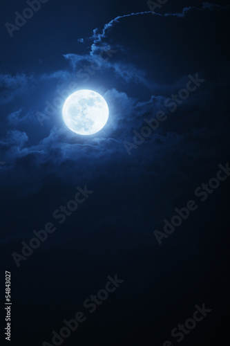 Fotobehang Volle maan Dramatic Nighttime Clouds and Sky With Beautiful Full Blue Moon