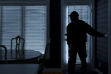 Burglar Breaking In To Home At...