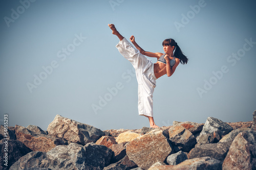 фотографія  Young girl training karate