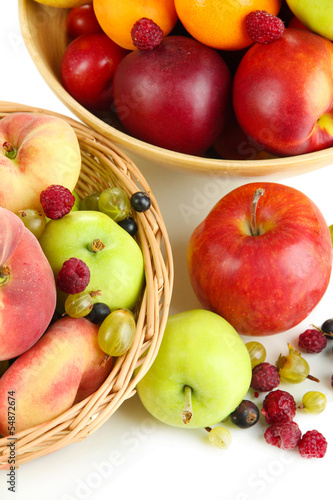 Tuinposter Bier / Cider Assortment of juicy fruits in wicker basket and wooden bowl,
