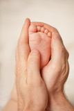 Love - newborn feet in father's hands