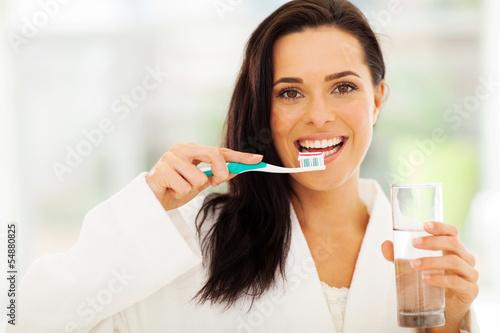 Obraz na plátně cute woman brushes her teeth