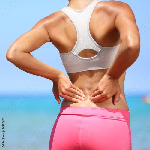 Fotografía  Back pain - woman having injury in lower back