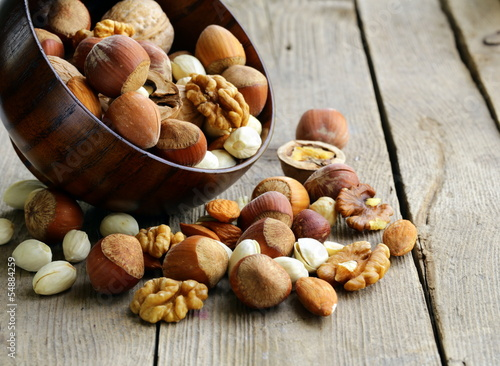 Mix nuts (almonds, hazelnuts, walnuts) on a wooden table
