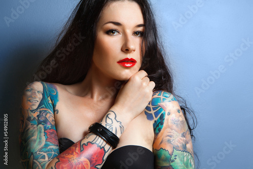 sexy woman with tattoo on her arms