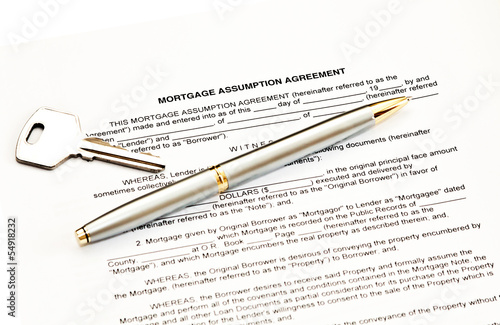 Mortgage Assumption Agreement With A Pen For Signature And A Key