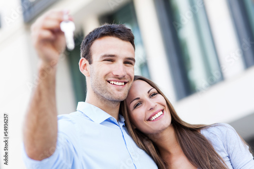 Fototapeta  Couple with new house keys