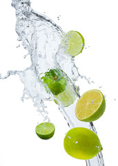 Fresh lime falling in water splash, isolated on white backgro