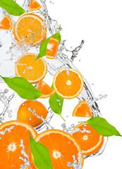 Fototapeta Fresh oranges falling in water splash, isolated