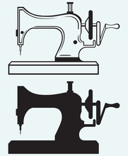 Antique Sewing Machine Isolated On Blue Background