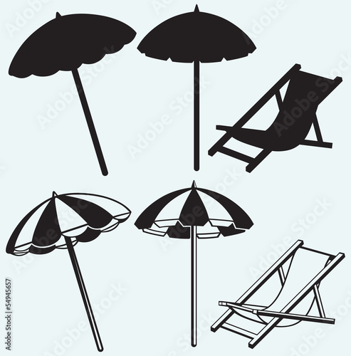 Slika na platnu Chair and beach umbrella isolated on blue background