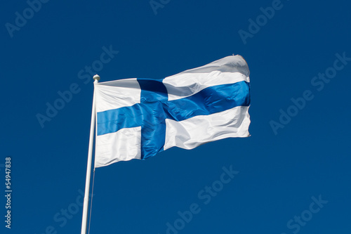 Foto op Aluminium Scandinavië Flag of Finland before blue sky.