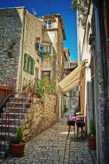 Obraz na Szkle Do baru Traditional old street of Croatia with cafe