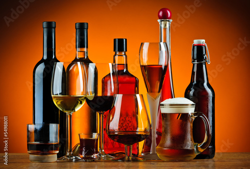 Bottles and glasses of alcohol drinks Canvas Print