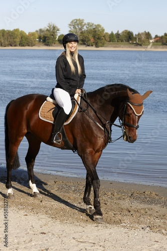 Foto op Aluminium Ontspanning Horse and rider at riverside