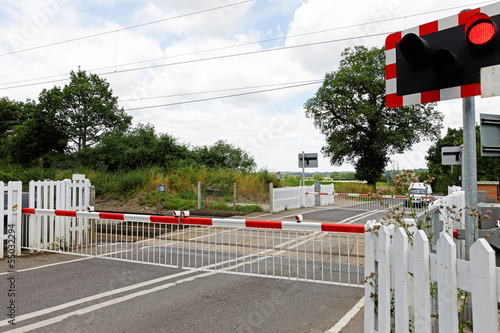 Fotografia, Obraz  Rural Level Crossing with Barriers Closed