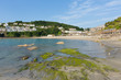 Beach at Looe Cornwall England with blue sea and sky