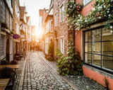 Fototapeta Alley - Historic Schnoorviertel at sunset in Bremen, Germany