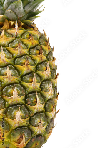 Fototapety, obrazy: Pineapple is located half of a white background