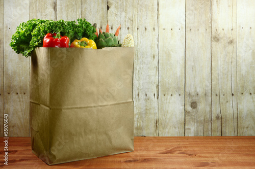Fotografía  Bag of Grocery Produce Items on a Wooden Plank