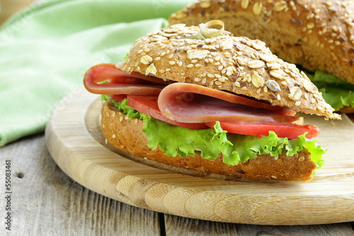 Foto op Canvas Snack sandwich of wholemeal bread with ham and tomatoes