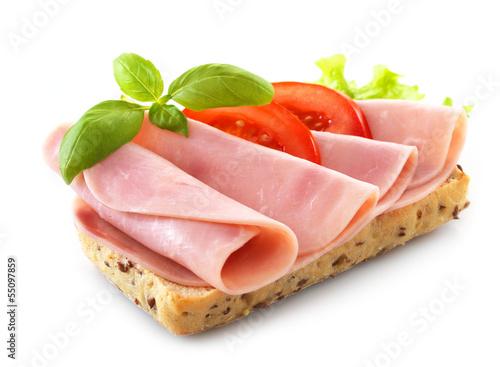 Fototapeta sandwich with pork ham on white background obraz