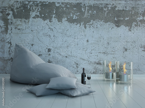 Photo White beanbag with pillows against concrete wall with candles