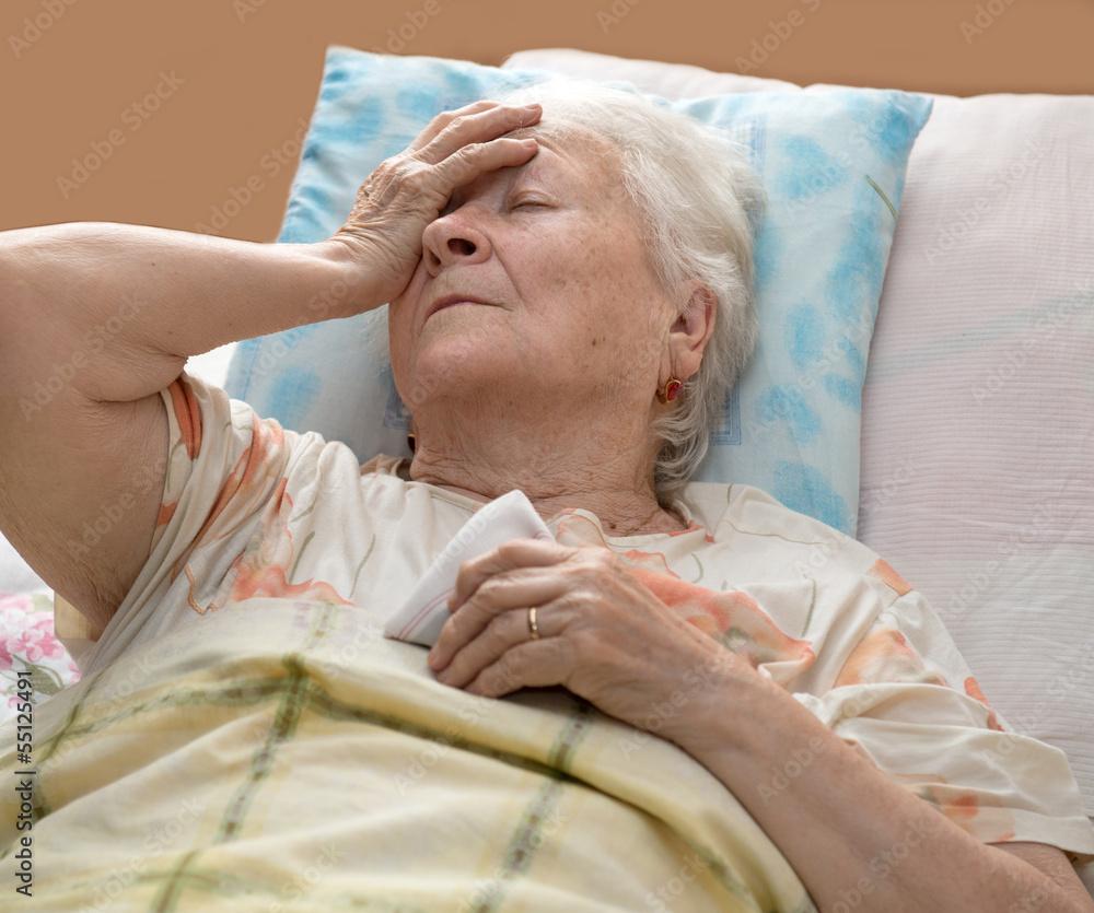 Fototapeta Senior woman lying at bed