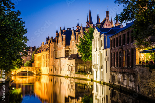 Staande foto Brugge Water canal and medieval houses at night in Bruges