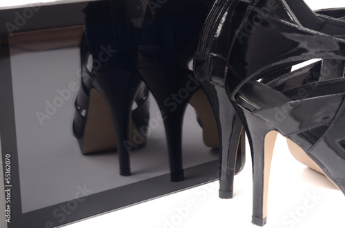 Fotobehang Snelle auto s High heels and tablet. Objects of a modern woman.