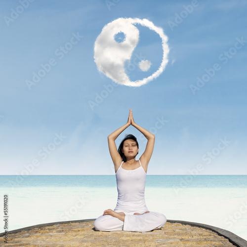Fotografie, Obraz  Yoga exercise under Yin Yang cloud