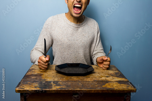 Hungry young man is screaming for his dinner Canvas-taulu