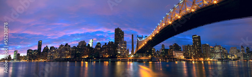 NYC Queensboro Bridge and Manhattan skyline panorama at dusk