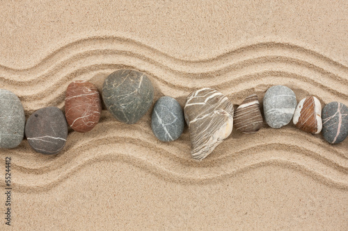 Foto op Plexiglas Stenen in het Zand Striped stones on the sand