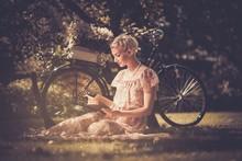 Blond Beautiful Retro Woman Reading Book